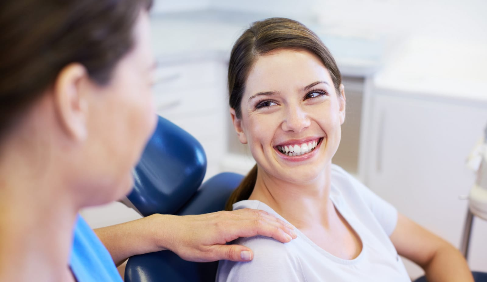 lady smiling in dentist chair photo